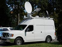 TV station truck in the front of Billie Jean King National Tennis Center in New York Royalty Free Stock Photos