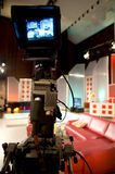 TV studio. With camera and lights - Digital video camera shoots meeting - view in video camera display - 3CCD Camcorder royalty free stock photography