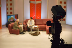 TV studio. With camera and lights - Digital video camera shoots meeting - view in video camera display - 3CCD Camcorder