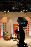 TV studio. With camera and lights - Digital video camera shoots meeting - view in video camera display - 3CCD Camcorder stock image