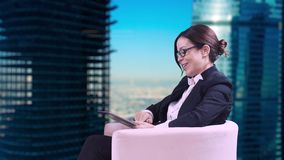 The TV Studio. Closeup of brunette in glasses. She sits in the Studio in a business suit and gives interviews. stock video footage