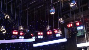 TV studio - grid lights. Colorful and black background stars stock video footage