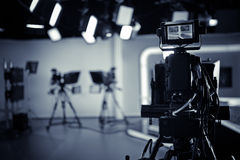 TV Studio live broadcasting.Recording show.TV NEWS program studio with video camera lens and lights. Positioned stage big professional broadcasting camera with stock photo