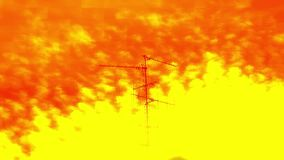 TV Television aerial antenna majestic cirrocumulus clouds. Distorted orange tv signal majestic cirrocumulus clouds on a summer afternoon with TV Television stock footage