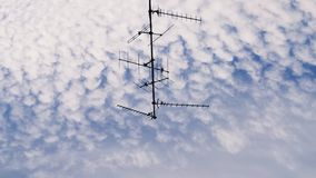 TV Television aerial antenna majestic cirrocumulus clouds. Majestic cirrocumulus clouds on a summer afternoon hanged from the sky TV Television aerial antenna in stock video