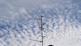 TV Television aerial antenna majestic cirrocumulus clouds. Time-lapse majestic cirrocumulus clouds on a summer afternoon with TV Television aerial antenna in the stock video
