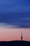 TV tower. On hill at sunset Royalty Free Stock Photography
