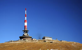 Tv tower. Antenna on mountain on beautiful sunny day stock photography