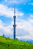 TV Tower, Almaty, Kazakhstan. TV Tower on koktobe hill against snow-covered peaks of Tien Shan mountains, Almaty, Kazakhstan Stock Photo