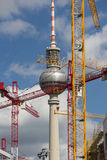 The tv tower in berlin behind construction cranes Stock Image