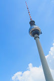 TV Tower in Berlin on the blue sky background. The building in the center of the Germany capital. Stock Image