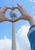 TV Tower in Berlin on the blue sky background. The building in the center of the Germany capital. Stock Photos