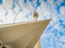 TV Tower in Berlin with modern architecture. TV Tower in Berlin with the roof of a modern building Royalty Free Stock Photo