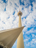 TV Tower in Berlin with modern architecture. TV Tower in Berlin with the roof of a modern building Royalty Free Stock Photography
