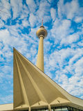 TV Tower in Berlin with modern architecture. TV Tower in Berlin with the roof of a modern building Royalty Free Stock Image