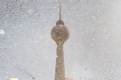 Tv tower Berlin water reflection in puddle.  Stock Images