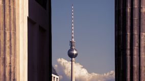 TV Tower Between Columns of Brandenburg Gate In Berlin. Germany stock image