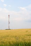 TV tower - far view. TV tower in the middle of wheat field Royalty Free Stock Photo