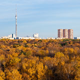 TV tower, houses and autumn trees and blue sky Stock Photography