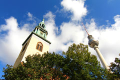 The TV Tower and the Marienkirche in Berlin Stock Photos