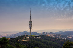 TV tower in the mountains. Torre de Collserola observation tower located on the Tibidabo hill, Barcelona, Spain Royalty Free Stock Photos