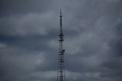 TV tower. Photo of a television tower in the background of gray clouds Stock Photos