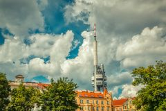 Tv tower in prague view from Jiřího z Poděbrad. Square under bright sun and clouds royalty free stock photos
