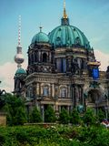 Berlin Dom Cathedral with the TV tower in the background. The TV tower rises up behind the grand Dom cathedral in Berlin, Mitte Royalty Free Stock Photo