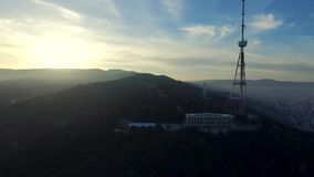 Tv tower sitting high on the hill, Georgia, aerial stock video footage