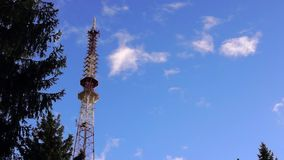 TV tower in sky. TV tower in blue cloudy sky stock video footage