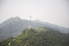 TV tower and a small summerhouse on Mountain. TV tower and a small summerhouse on the peaks of the mountains in the Wu Tong mountain, shenzhen, China royalty free stock photo
