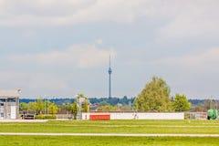 TV Tower of Stuttgart Stuttgarter Fernsehturm - foresight view. TV Tower Stuttgart - view from Airport Stuttgart, green meadow an runway in front Royalty Free Stock Photos