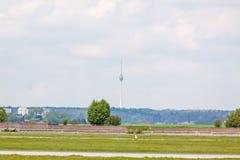 TV Tower of Stuttgart Stuttgarter Fernsehturm - foresight view. TV Tower Stuttgart - view from Airport Stuttgart, green meadow an runway in front Stock Photo