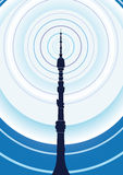 TV Tower. Transmits a radio signal on a background of blue sky Stock Photos