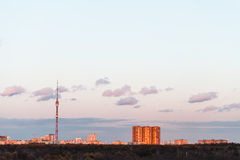 TV tower and urban buildings in spring sunset Stock Photography