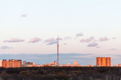 TV tower and urban houses in spring sunset Royalty Free Stock Image