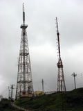 TV Towers. The antennae of large retro TV towers at a television station, against a cloudy sky stock photo