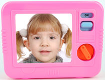 Tv toy with little girl Royalty Free Stock Photo