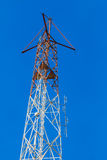 TV transmitter antennas on blue sky Stock Images