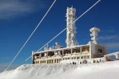 TV transmitter on snowy mountains Stock Photos