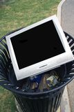 TV Trash. Television or Monitor laying in a trash can Royalty Free Stock Photo