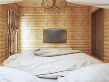 TV unit in a modern bedroom interior in a log. Royalty Free Stock Photos