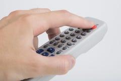 TV van de afstandsbediening op wit Stock Fotografie