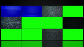 TV video wall with twelve television screen displaying noise and changing to green screen mate.
