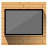 TV on wall  brick Stock Photography