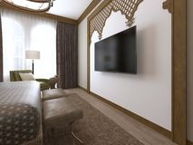 A TV on the wall and a TV stand, wooden carvings framed in Middle Eastern Arabic style. 3D rendering stock illustration