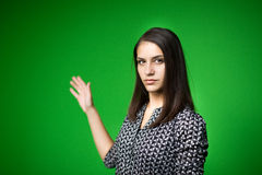 TV weather news reporter at work.News anchor presenting the world weather report.Television presenter recording in a green screen Royalty Free Stock Images