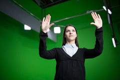 TV weather news reporter at work.News anchor presenting the world weather report.Television presenter recording in a green screen. Chroma key studio.Journalist stock image