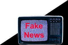 TV on white and black background interference and the inscription fake news royalty free stock photography