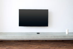 TV on white wall in living-room Royalty Free Stock Photo